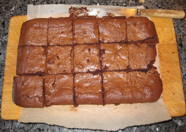 Baked brownies out the tin and sliced into 15 pieces