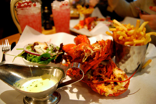 Grilled lobster with garlic and parsley sauce, fries and salad