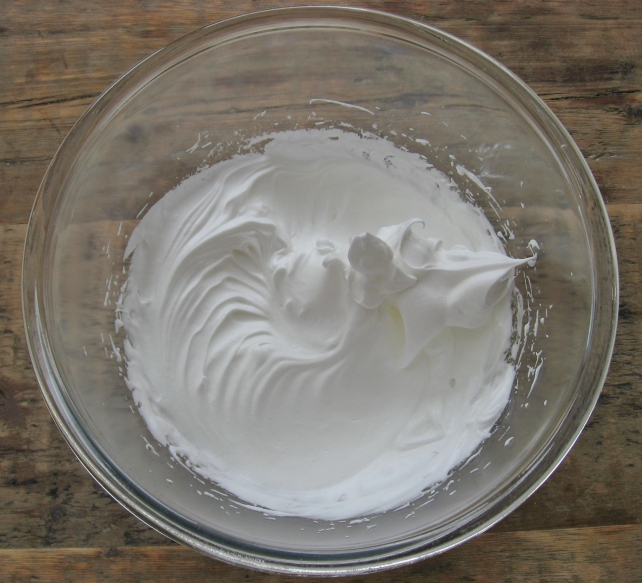 Caster sugar added to the whisked egg whites to make a glossy mixture
