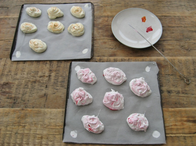 Meringues ready to be cooked, swirled with pink and orange
