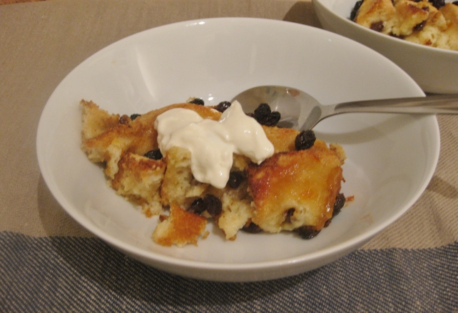 Marmalade and raisin bread and butter pudding, served with creme fraiche