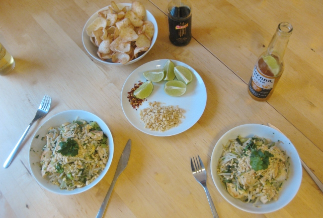 Homemade chicken Pad Thai served with prawn crackers and Corona