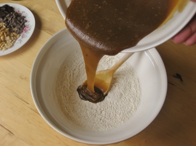 Mixing the wet and dry ingredients for chocolate and peanut cookie dough