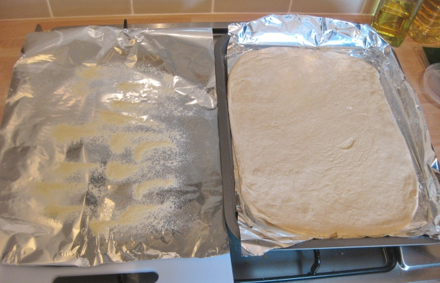 Rolling out the homemade pizza dough