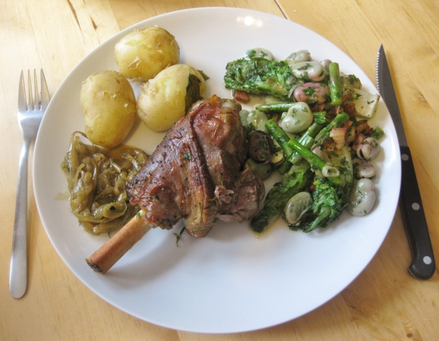 Slow-roasted lamb shank with new potatoes and spring vegetable stew