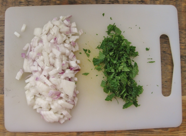 Chopped red onion and mint for watermelon salad