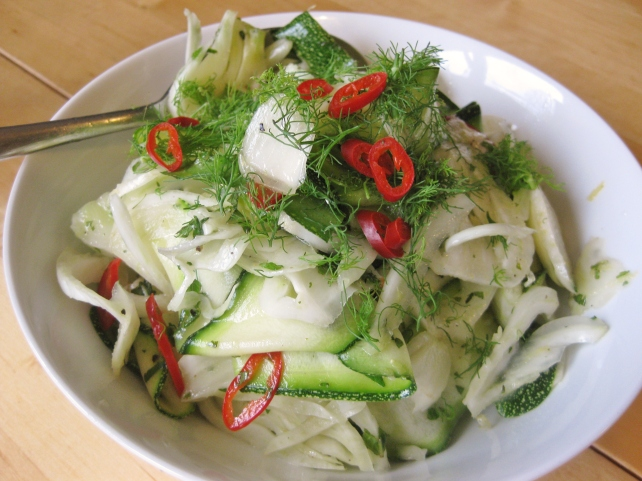 Courgette and fennel salad  topped with fennel fronds and red chilli