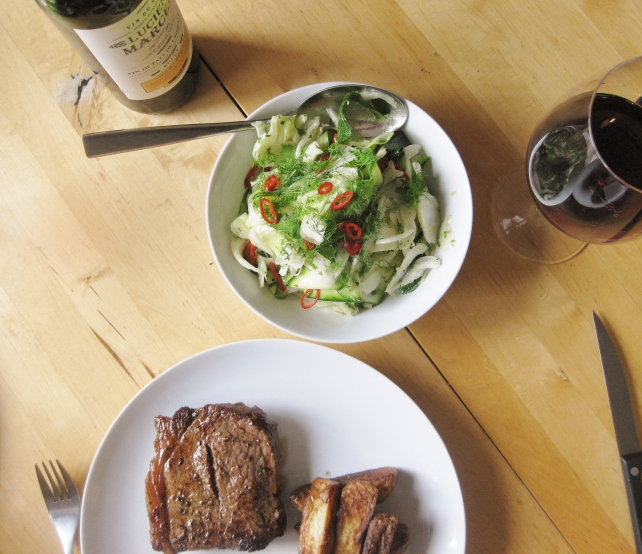 Courgette and fennel salad served with steak, chips and red wine