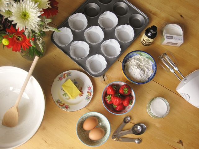 Ingredients for homemade strawberry and vanilla muffins
