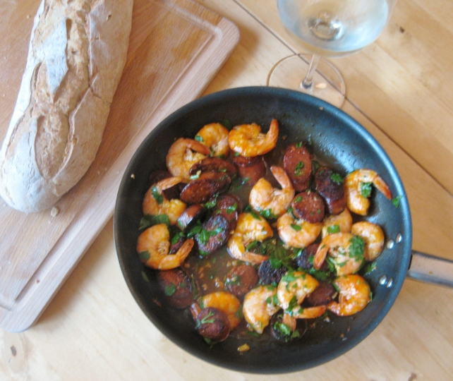 Prawns and chorizo served with bread and white wine