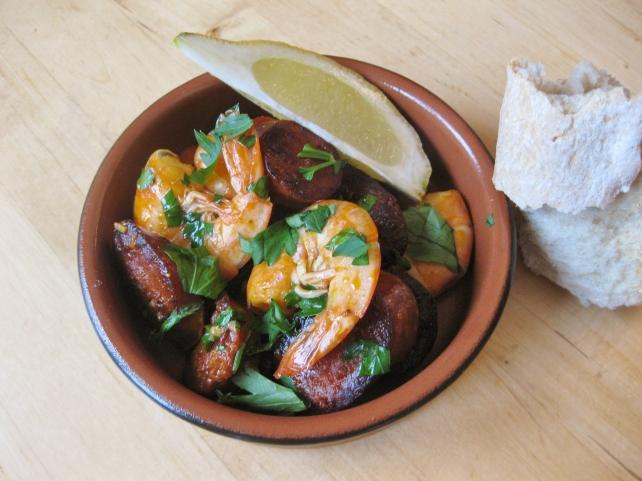 Spanish tapas of prawns and chorizo with garlic and white wine
