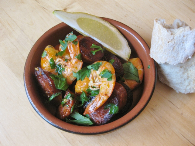 Spanish tapas of prawns and chorizo with garlic and white wine