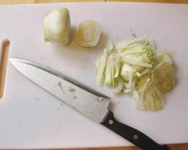 Thinly slicing the fennel for a raw salad