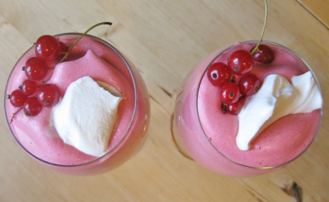 Hot redcurrant and raspberry mousse served with berries and creme fraiche
