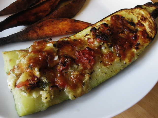 Stuffed courgette served with sweet potato wedges