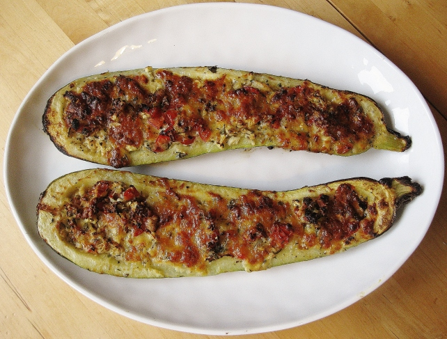 Stuffed courgettes with tomatoes, basil and parmesan
