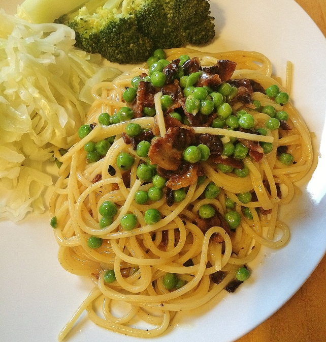 Pasta carbonara served with steamed vegetables