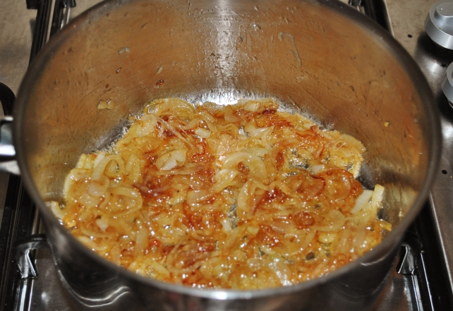 Adding brown sugar to the onions