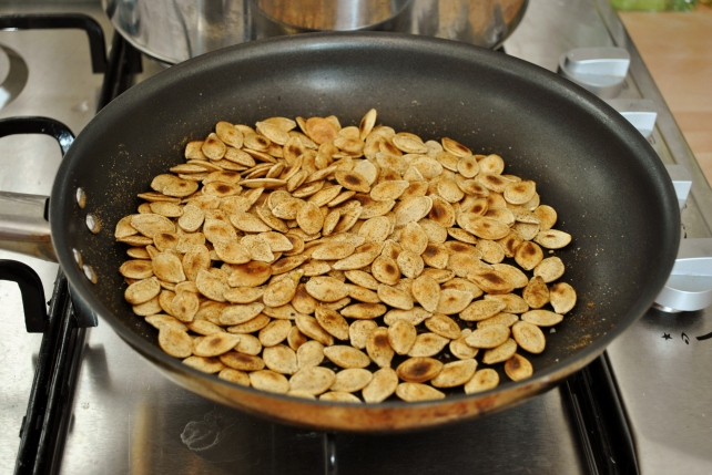 Dry frying the pumpkin seeds with spices