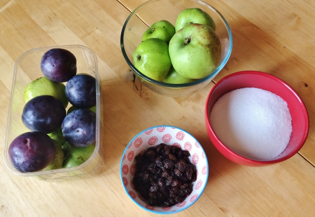 Ingredients for stewed apples and plums