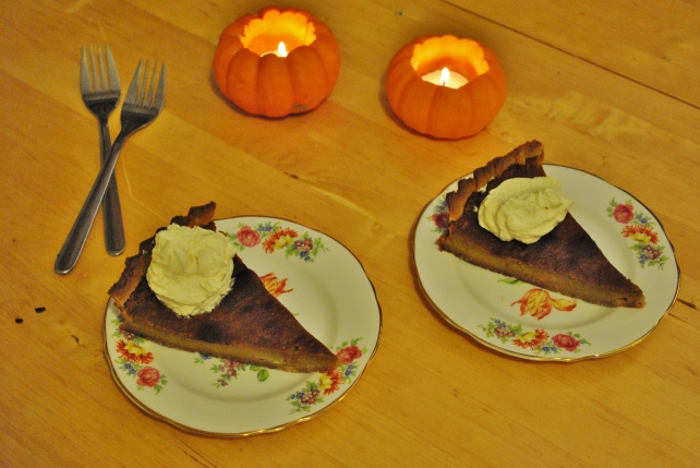 Slices of pumpkin pie served with maple cream