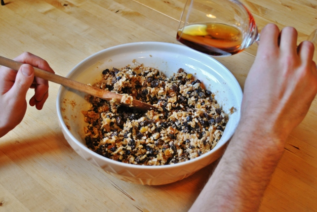 Adding brandy to the Christmas pudding mix