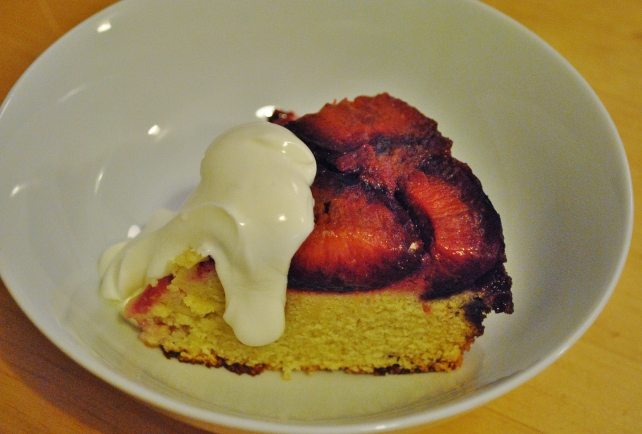 Upside down plum cake served with creme fraiche