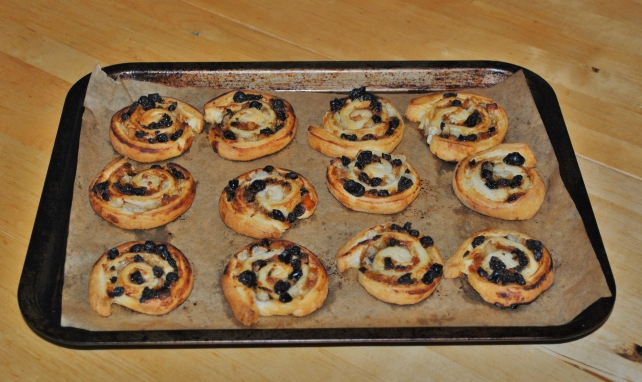 Baked puff pastry rolls stuffed with mincemeat