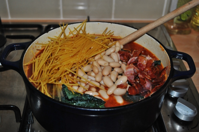 Adding the extras for a hearty minestrone soup