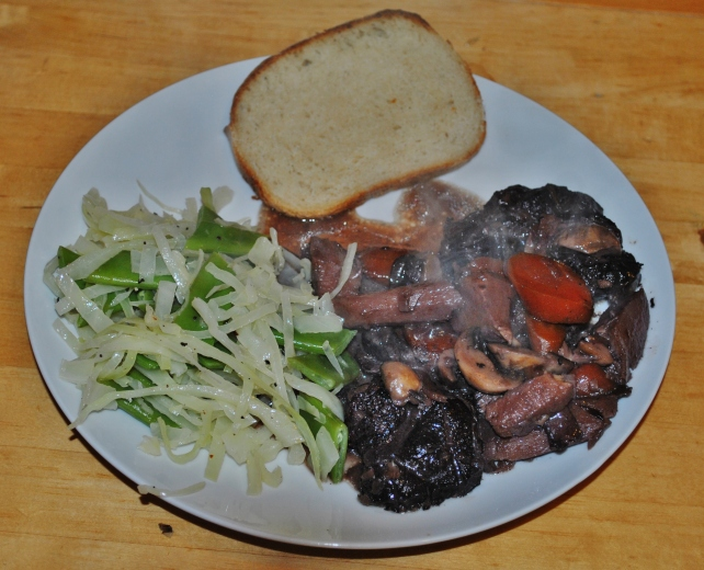 Beef shin casserole served with green vegetables and homemade bread