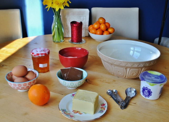 Ingredients for orange and milk chocolate celebration cakes