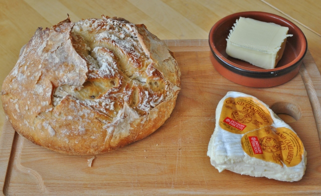 Crusty white Le Creuset loaf served with butter and camembert 1
