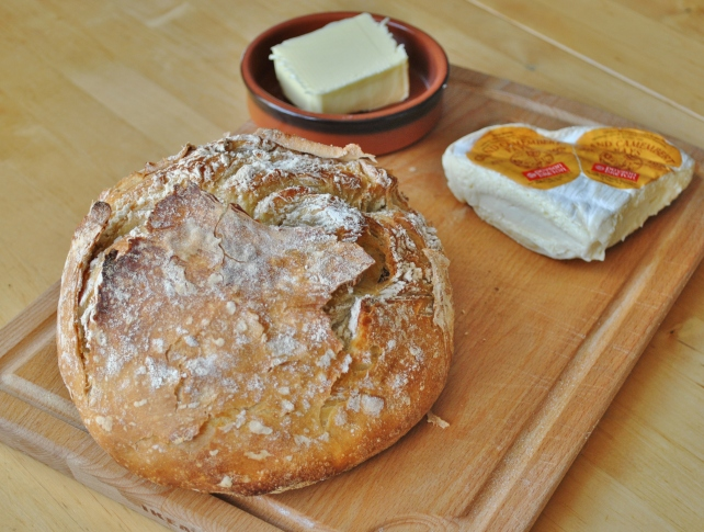 Crusty white Le Creuset loaf served with butter and camembert 2