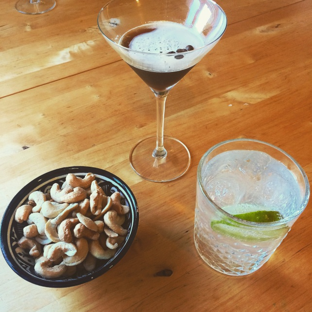 Espresso martini, gin and tonic and cashew nuts