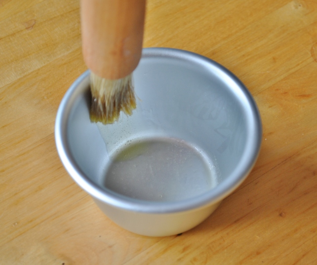 Brushing the inside of the pudding tin in upward strokes 2
