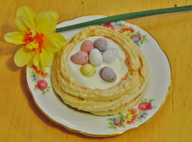 Easter meringue nest filled with greek yogurt and mini eggs