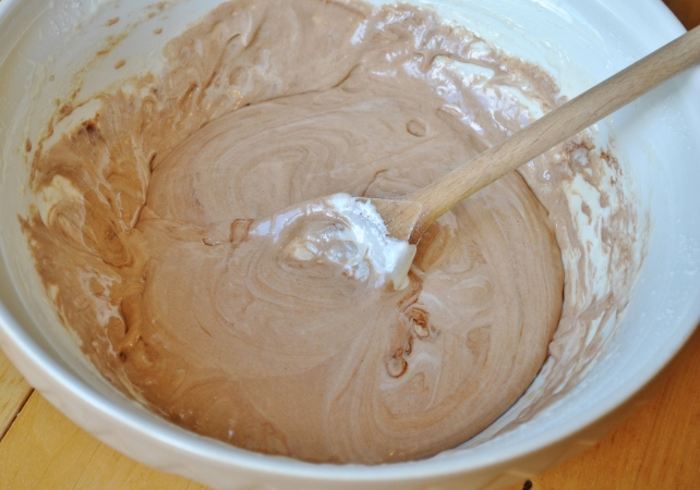 Starting to add the chocolate mixture to the fondant batter