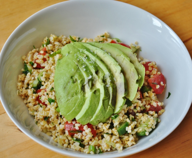 Tabbouleh salad served with ripe avocado for lunch