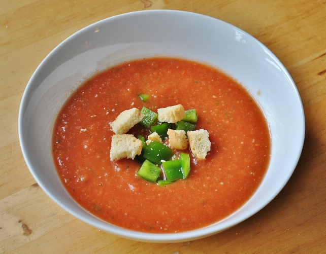Gazpacho soup served with green pepper and croutons