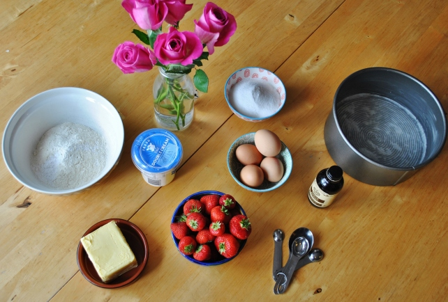 Ingredients for Victoria sponge cake with strawberries and cream