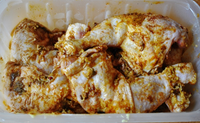 Marinading the chicken legs for Moroccan tagine