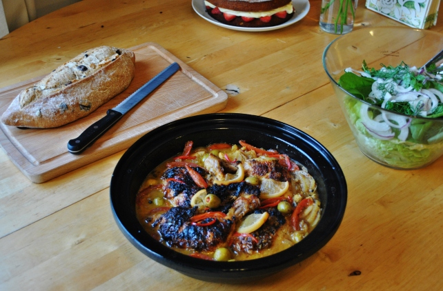 Moroccan chicken tagine served with olive bread and green herb salad