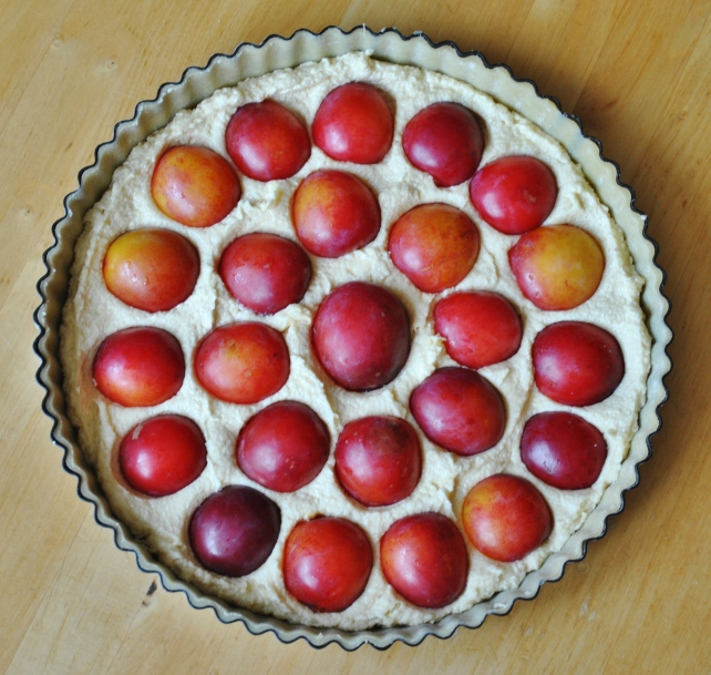 Arranging the plums in the pastry case 1
