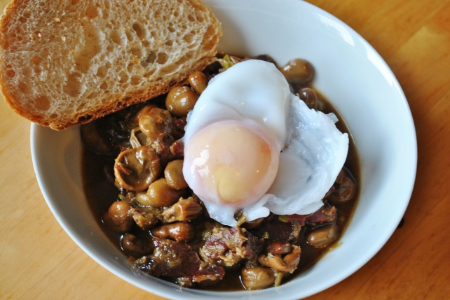 Habas con jamon served with a poached duck egg and sourdough bread