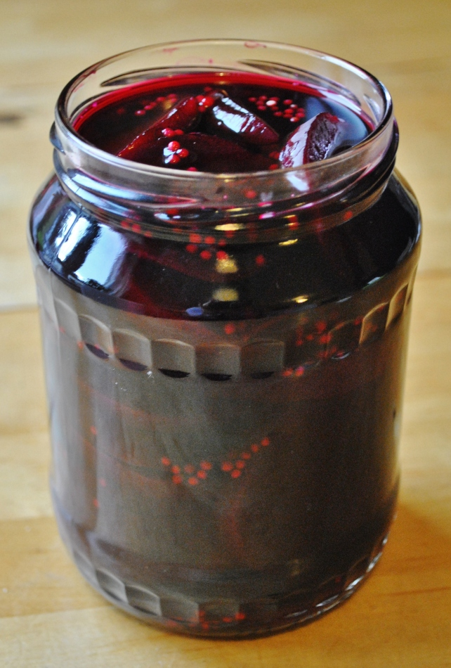Pouring the hot pickling liquor over the sliced beetroot