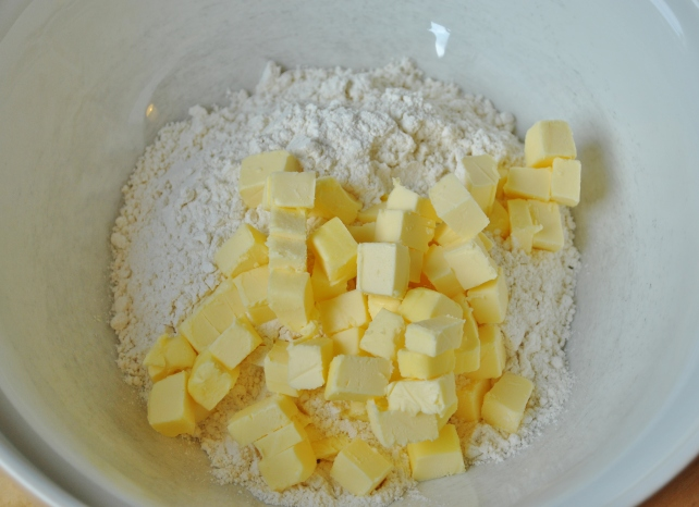 Adding chilled butter to the plain flour