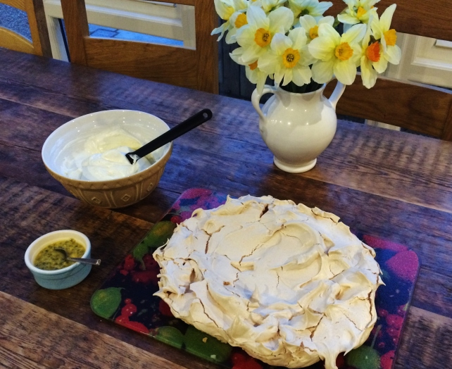 Preparing to fill and top the pavlova