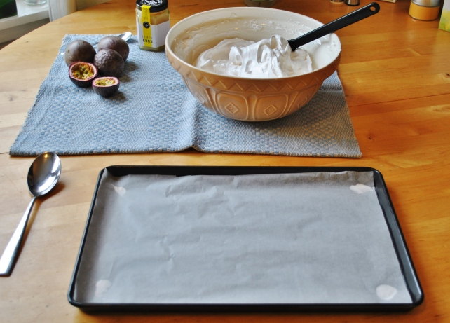 Preparing to shape the pavlova on a lined baking sheet
